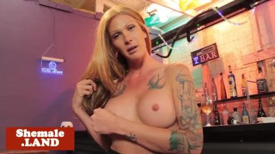 Bigtitted tattooed tgirl assfucked in bar
