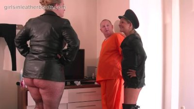 Kinky leather clad femdoms make inmate slave lick the cream off their boots