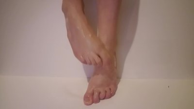 Sexy feet get wet and sticky