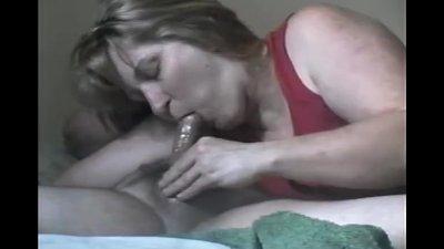 Housewife sucks husbands oil soaked cock till he cums hard..