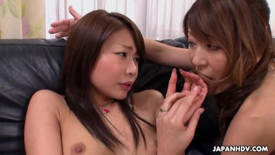 Two cute asian sweet hearts play with a sex toy