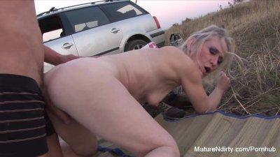 Blonde mature sucks & fucks outdoors