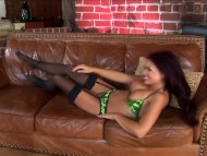 Busty Eva getting fucked on the couch wearing stockings and a garter belt