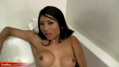 Adorable feminine ladyboy stips for a bath and strokes cock
