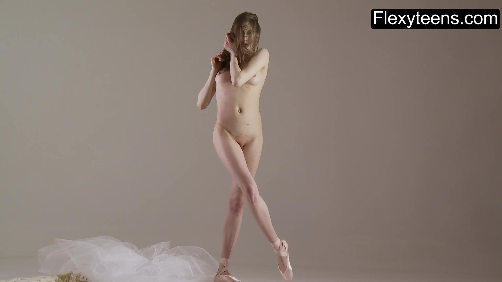 Solo girl/gymnast performs gymnastics blonde