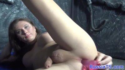 Russian tgirl sucks dildo before toying ass