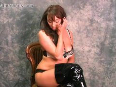Busty Babe Seductively Puts On Black Leather Thigh Boots Strips To Panties