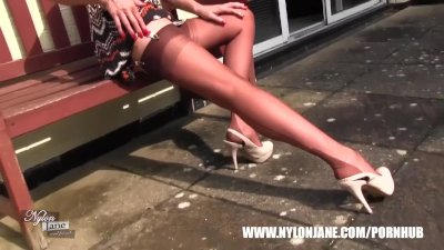 Milf Nylon Jane teases in sexy pair of nylon stockings suspenders and heels