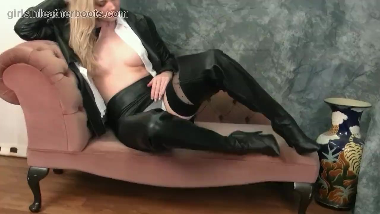 Busty blonde babe lets you upskirt and opens blouse in nylons leather boots