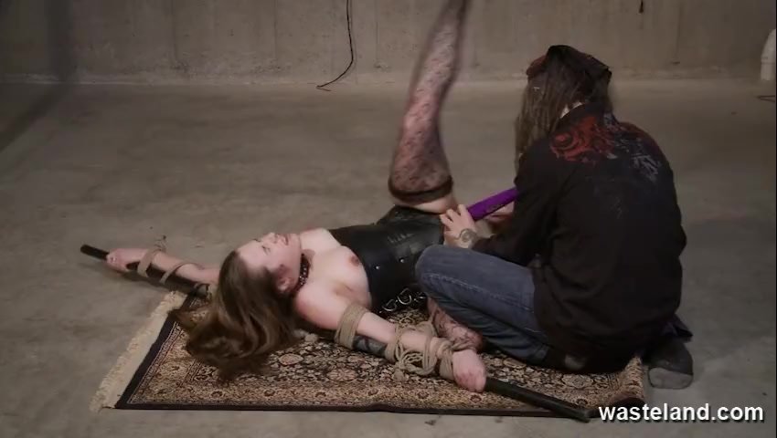 BDSM Floor Workout. Pretty female submissive bound on the floor and caned