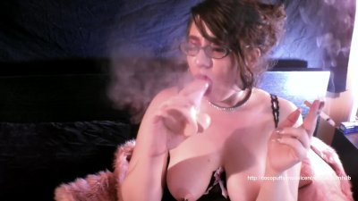 Coco gives a smokey blowjob with red lips