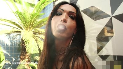 Shemale Carla Blows Smoke Rings in your face