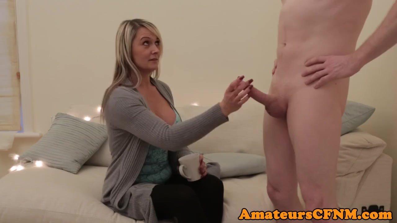 Mature CFNM babe stroking big cock