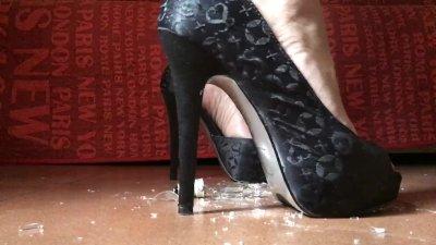 Crushing light bulb with high heels