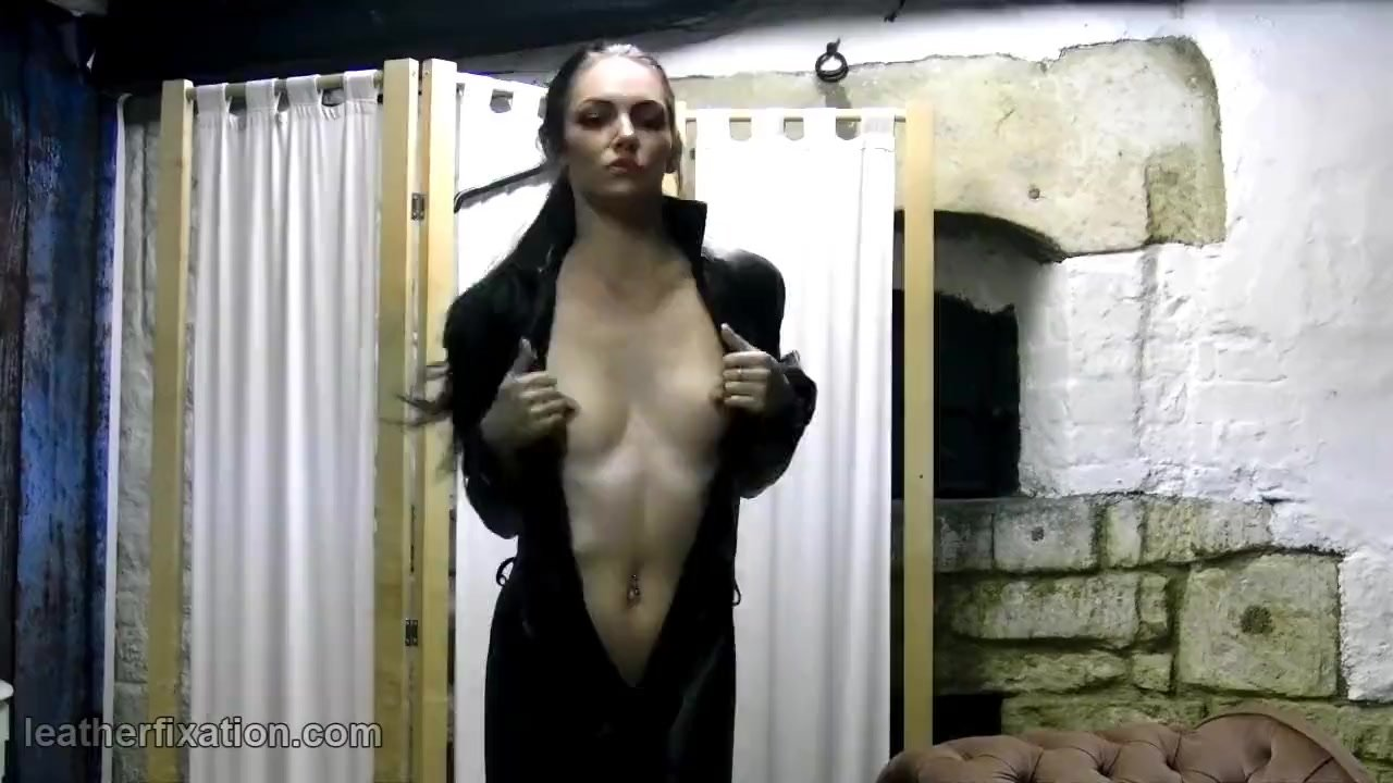 Sexy babe strips naked to put on tight leather catsuit and leather pants