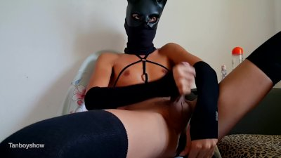 Tanned Femboy play with vibrator dildo