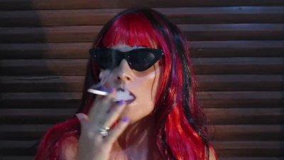 Hot redhead chick smoking