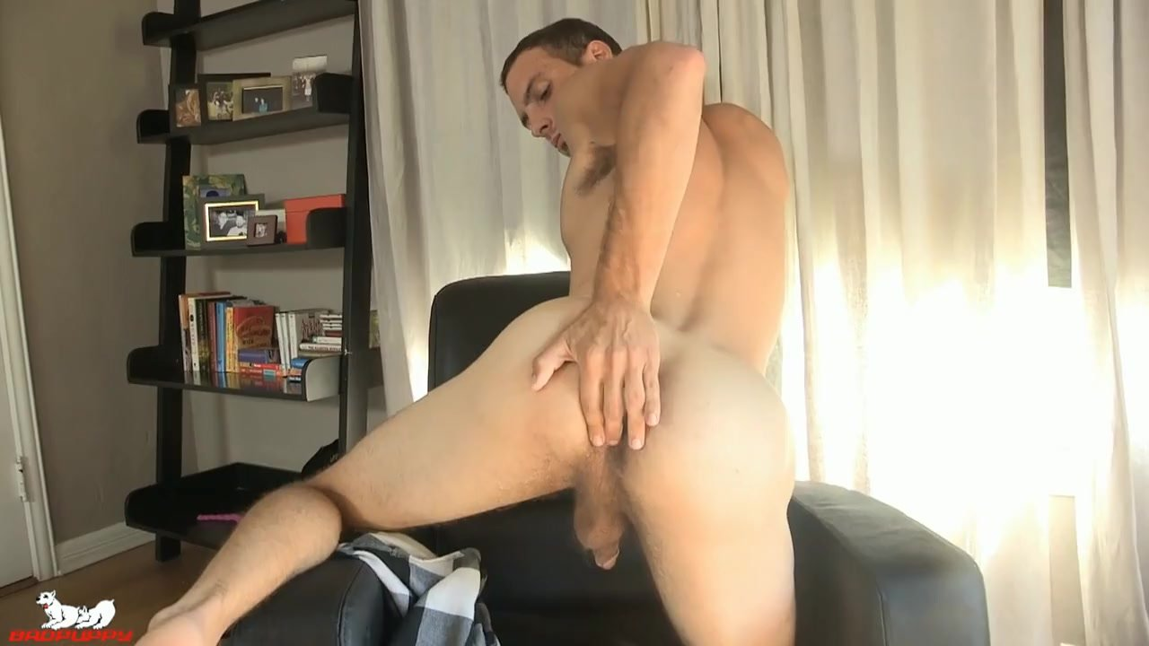 Cameron Hardy turns to the camera & his cock is rock-hard