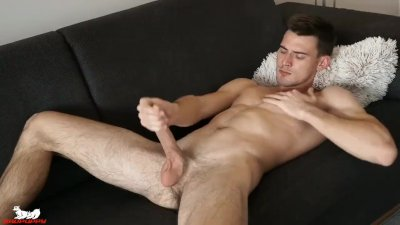 One hand slips down and begins playing with his ass