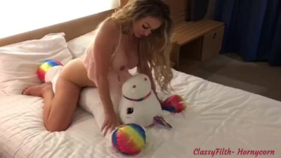 Classy Filth Rides And Desecrates Her HornieCorn Teddy, Squirts All Over it