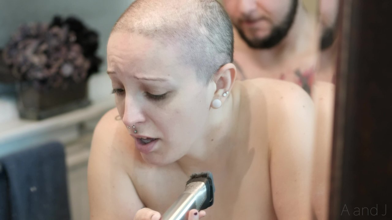 Michelle having her head shaved