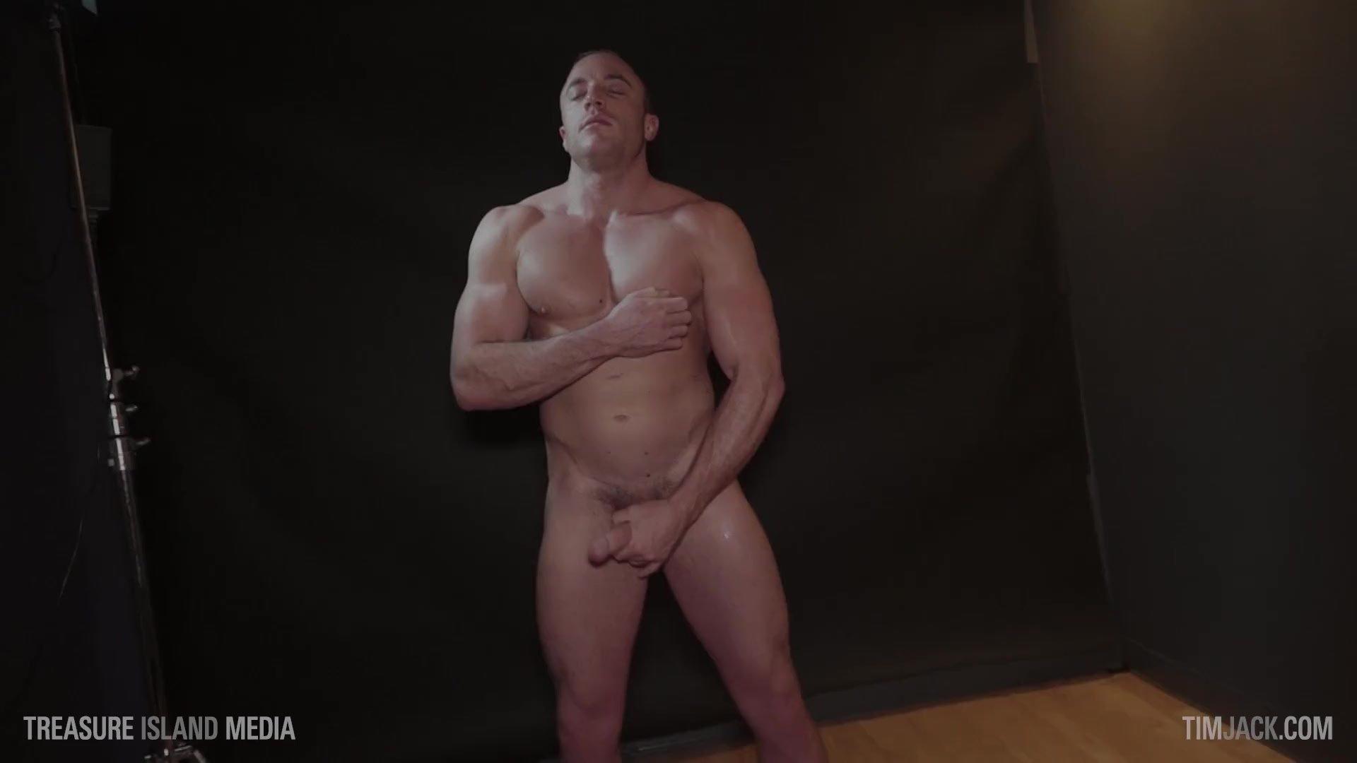 Jerking off a muscle stud while he tweaks his big nips