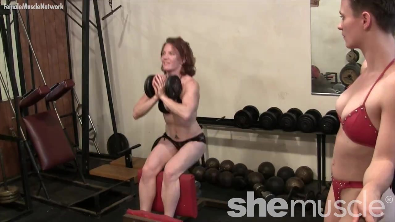 Two fit women softcore workout in the gym