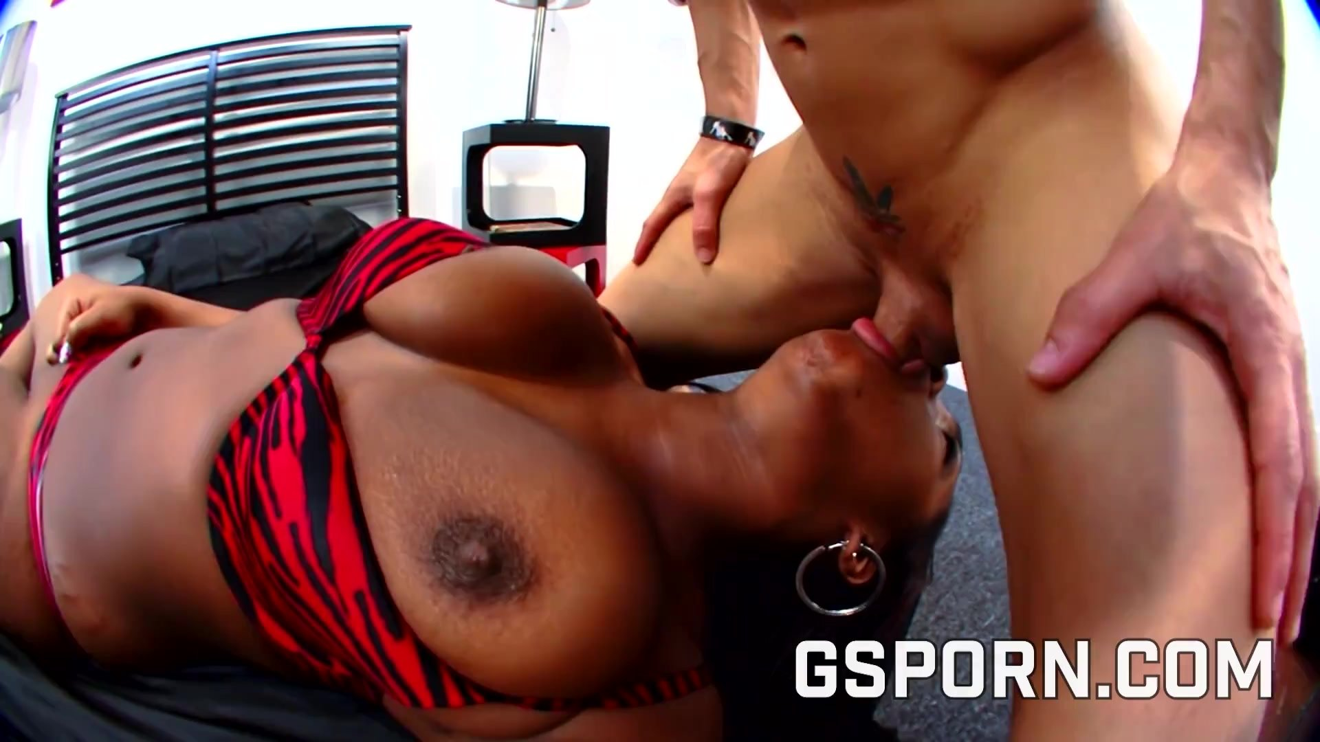 Black milf with big natural tits fucking hard on the bed
