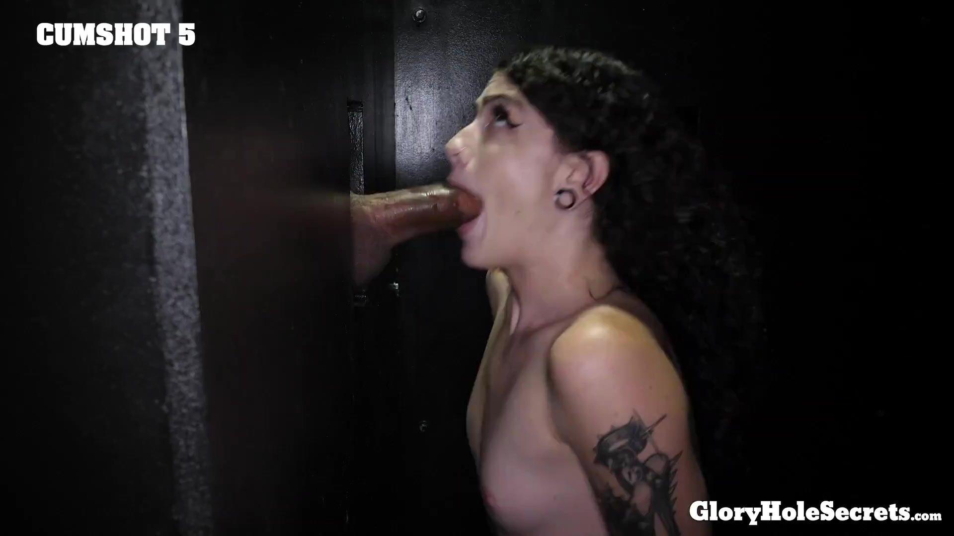 Skinny tattooed Girl sucks dicks in the gloryhole